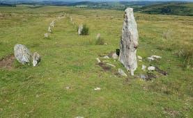 Dartmoor prehistoric small standing stones on open grassy moor