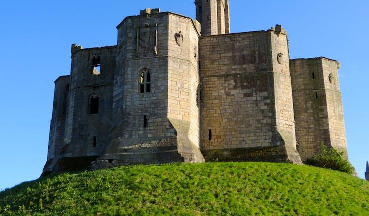 Keep of mediaeval castle on hilltop Northumberland