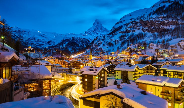 Winter evening scene with lights of Zermatt with Matterhorn in distance