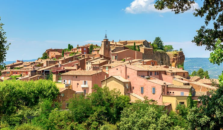 Pink-tinged houses on hill village of Roussillon in Luberon Provence