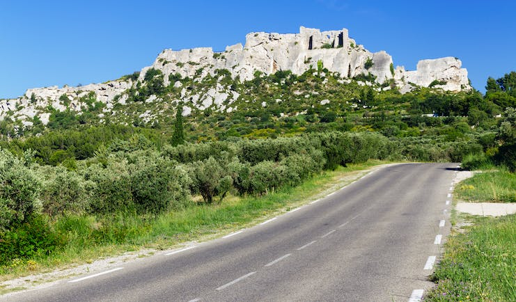 Hill town of Les Baux de Provence with road in foreground