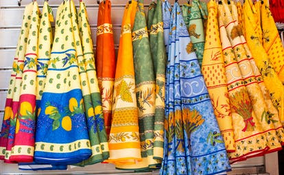 Multi coloured fabric tablecloths in Provence patterns
