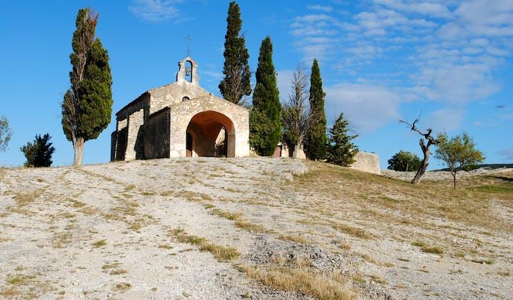 Alpilles Provence scenery chapel on barren hill