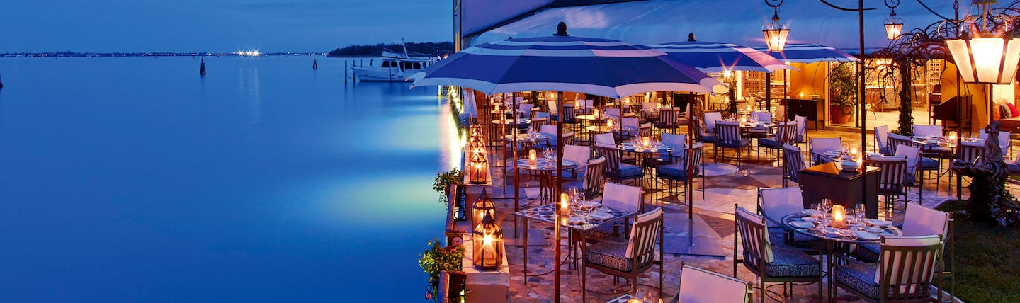 Terrace next to water with evening light for dining
