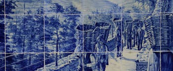 Blue ceramic tiles of vineyard workers carrying baskets of grapes